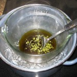 Salve as it begins to cook.  Notice the beeswax floating in the oil.